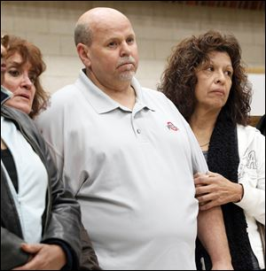 Darlene Cole, left, Bob DeShetler, and Dora Martinez, whose jobs are being terminated, listen as UAW Local 12 President Bruce Baumhower tells them Chrysler did not try to save their jobs. Chrysler asked them to retire and work for a Jeep supplier; Chrysler is now taking the work in-house and getting rid of their jobs.