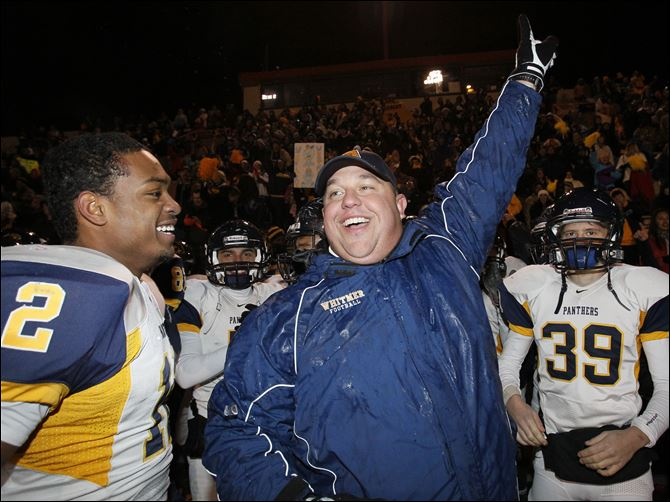 Whitmer Jerry Bell Whitmer coach Jerry Bell celebrates a victory in the state semifinals. The Panthers have reached the state final for the first time.