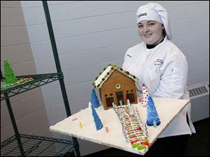 Stephanie Horton, 17, of Anthony Wayne High School, holds her gingerbread house.