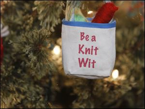 An ornament hangs on a Christmas tree during an open house at Yarn Cravin' in Perrysburg.