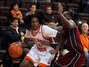 BGSU's Alexis Rogers dribbles around Temple's Sally Kabengano.