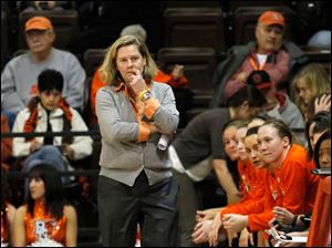 BGSU head coach Jennifer Roos watches her team trailing in the game.