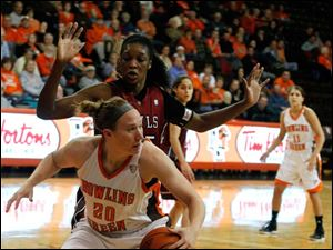 BGSU's Allison Papenfuss keeps the ball away from Temple's Victoria Macaulay.
