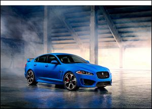 The 2014 Jaguar XFR-S sedan sports a 550-horsepower supercharged V-8 engine that avoids a gas-guzzler tax by getting 23 mpg on the highway. The car starts at $99,000 and goes on sale this summer.