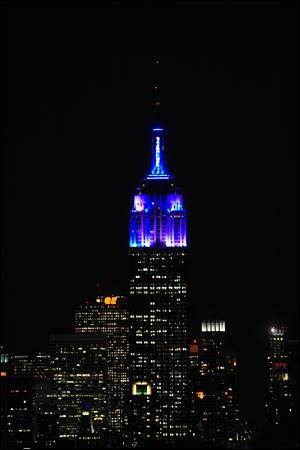 The top floors of New York's Empire State Building are lit in blue and white light after being switched on by R&B star Alicia Keys. The landmark boasts a new LED lighting system with a palette of more than 16 million colors in limitless combinations, including ripples, sparkles, chasers, sweeps, strobes and bursts.