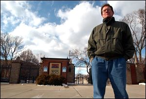 Tim Reichard, outside the Toledo Zoo's Broadway entrance, was dismissed after more than 22 years as its veterinarian.