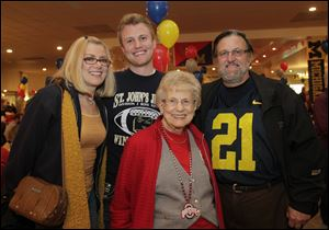 From Left: Barb Mann, Billy Mann, the event co-ordinator, with his grandmother Rita Pletcher and father, Rick Mann. The Border Battle Bash to benefit the Boys & Girls Clubs of Toledo: 19th annual celebration of the OSU/UM Rivalry, held in Maumee.