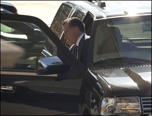 Former Republican presidential candidate Mitt Romney arrives at the White House for a luncheon with President Barack Obama.