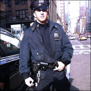 Officer Larry DePrimo is shown on-duty.