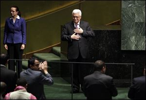 Palestinian President Mahmoud Abbas acknowledges applause after he addressed the United Nations General Assembly.