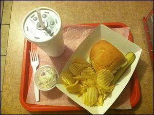 A shredded barbecue sandwich, chips, potato salad, and drink at O'Deer diner cost about $5.