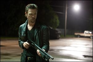 Brad Pitt is a gun for hire in