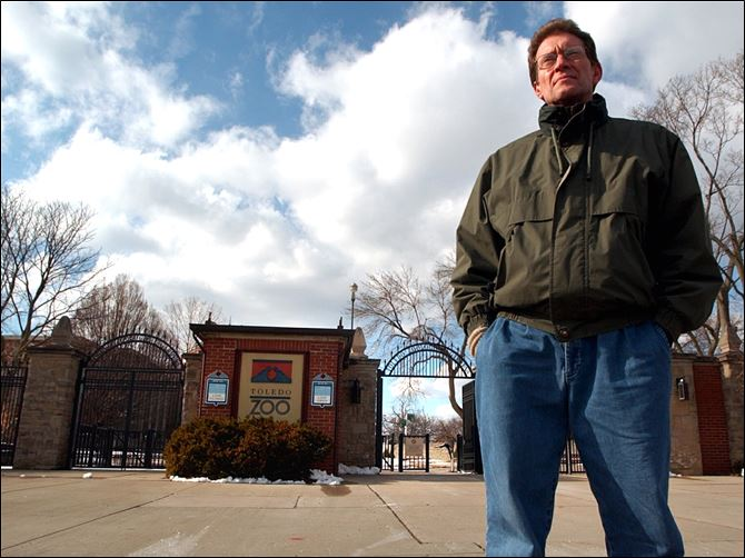CTY zoo11p.jpg reichard outside broadway gates of zoo Tim Reichard, outside the Toledo Zoo's Broadway entrance, was dismissed after more than 22 years as its veterinarian.