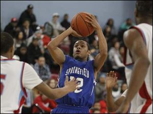 Springfield High School player Curtiss Hassell, 12, puts up a shot against Bowsher.