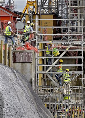 Construction of the new set of locks is 24-hour operation as Panama works towards 2015 completion date. Workers move up the scaffold at the construction site of one of the locks.