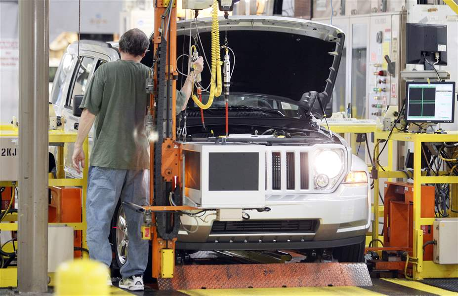 An-employee-works-on-a-Jeep-Liberty