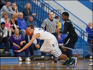 Start's Keith Foreman (20) defends against Anthony Wayne's Matt Fox (3) for a loose ball rebound.