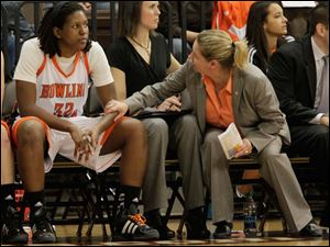 BGSU coach  Jennifer Roos talks to forward Alexis Rogers on the bench after officials called Rogers for a flagrant foul after several minutes of game film review.