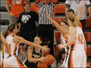 BGSU players Chrissy Steffen, Jill Stein, and Danielle Havel move in on defense against CSU's Taylor Varsho.