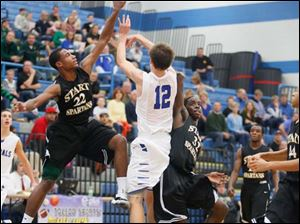Start's Chris Adams (22) and Scott Hicks (32) defend against Anthony Wayne's Jake Reid (12).