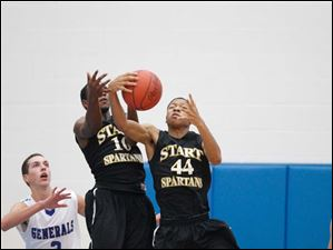 Start's Dwayne Shy (44) and Dexter Johnson (10) pull in a rebound against Anthony Wayne's Matt Fox (3).