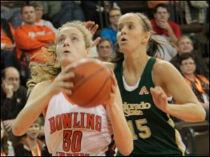 BGSU's Miriam Justinger looks to shoot while defended by CSU's Amber Makeever.