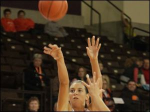 BGSU's Chrissy Steffen takes a shot over the outstretched hand of a Rams defender.