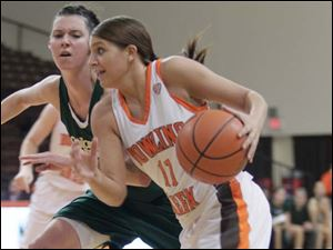 BGSU's Jillian Halfhill drives around CSU's Emily Johnson.