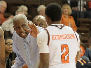 BGSU Coach Louis Orr congratulates Anthony Henderson during a time out.