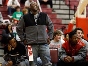 Central Catholic's Chris Green laughs during a rally for his team.