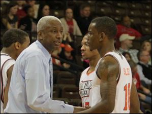 BGSU Coach Louis Orr congratulates Craig Sealey after a good play in the second half against YSU.