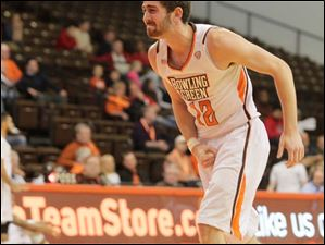 BGSU's James Erger grimaces as he comes off the court.