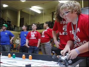 Team Lego programmer Cody Allen sets up his robot for competition.