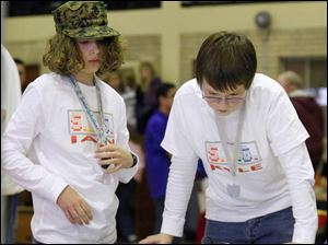Timberstone Jr. High students Ian Mahoney, left, and Kyle Braden watch their robot.