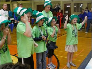 Sylvan Elementary School 4th grader Melanie Gromes, right, and her team react to their robot completing a task.