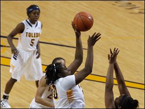 UT's Brianna Jones shoots over SIU's Kiara Conner.