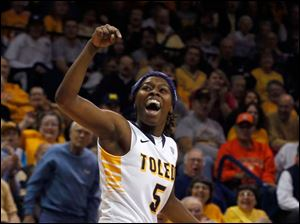 UT's Janelle Reed-Lewis reacts to scoring during game.