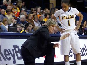 UT head coach Tricia Cullop gives direction to freshman Michele Hayes.