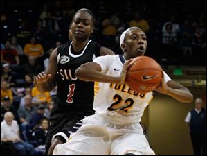 SIU's CoCo Moore guards UT's Andola Dortch as Dortch.