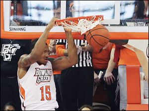 Bowling Green's A'uston Calhoun dunks the ball while Youngstown State's Shawn Amiker looks on. Calhoun finished with 12 points in the loss for the Falcons.