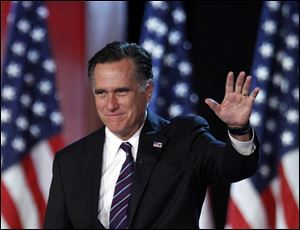 Republican presidential candidate, former Massachusetts Gov. Mitt Romney waving to supporters at an election night rally in Boston. Romney's shadow looms over a GOP in disarray.