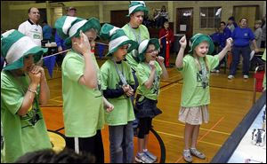 Melanie Gromes, right, a fourth grader at Sylvan Elementary, cheers on her  team's robot.