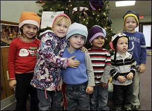 Modeling hats collected at Love 'n' Learn day care are, from left: Lucy Printke, Mayley and Crosby Mannebech, Riley Clegg, and Mackston and Maddock Robson.