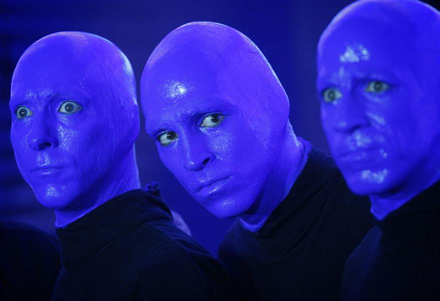 Members-of-the-Blue-Man-Group-promote-their-new-show