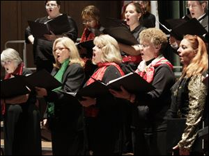 Members of the Lourdes University Chorus sing. From left, front row: Barbara Manny of Toledo; Tena Ernst of Sylvania; Wanda Anderson of Toledo; Sandi Hawk of Toledo; and Jill Hojnacki of Wauseon.