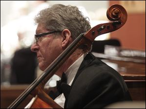 Gary Brown, cellist, accompanies the Lourdes University Chorus.
