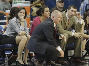 The St. Bonaventure coaching staff, from left, assistant coaches Kate Achter and Andrea Doneth, head coach Jim Crowley, and assistant coach Ryan Gensler. Achter, a graduate of Clay High School in Oregon, was an All-American point guard at Bowling Green.