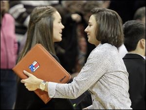 Former Bowling Green State University guards Jessica Slagle, left, and Kate Achter after the game. Slagle is is the graduate assistant manager for the the UT women, and Achter is an assistant coach for St. Bonaventure.