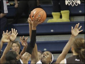 Toledo's Yolanda Richardson blocks a shot by St. Bonaventure's Alaina Walker.