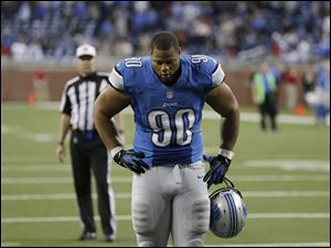 Detroit Lions defensive tackle Ndamukong Suh walks off the field after the Lions lose 35-33 to the Indianapolis Colts in an NFL football game at Ford Field in Detroit, Sunday, Dec. 2, 2012.